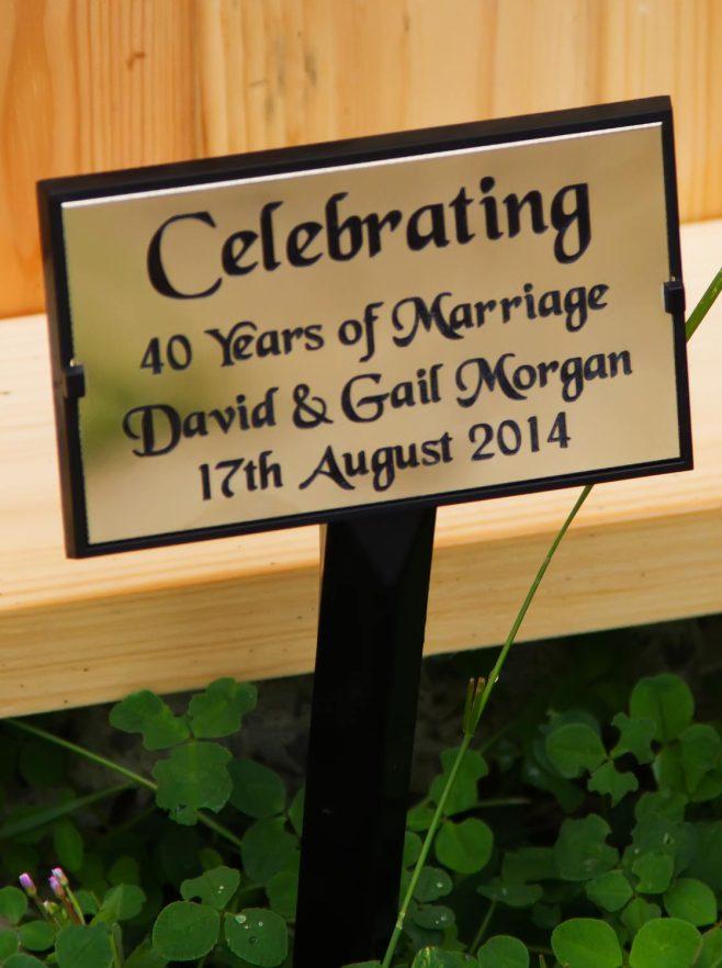 http://www.sign-maker.net/engraved/plant-stake-grave-marker.html