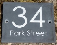 Well laid out slate address sign. Font Century Gothic