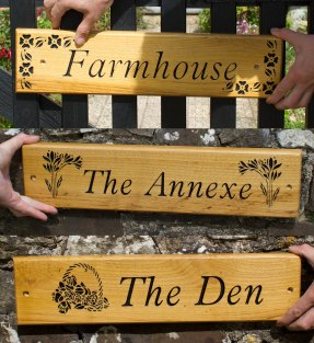 Oak Sign - https://www.sign-maker.co.uk/made-to-measure-oak-signs-5217-p.asp