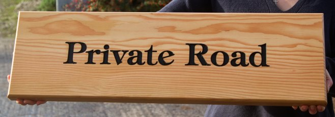 Low maintenance wooden signs