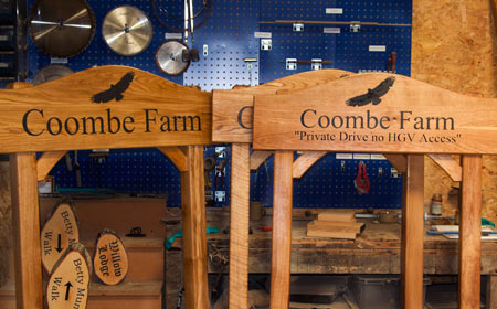 Wooden Signs (don't forget to add the posts!) -https://www.sign-maker.co.uk/made-to-measure-iroko-house-signs-5375-p.asp