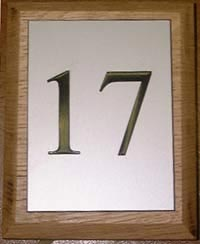 wooden sign with plaque