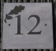 Slate sign with raised image and number