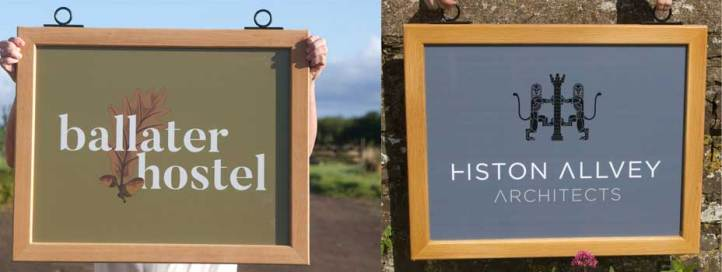 Framed hanging signs with printed vinyl boards.