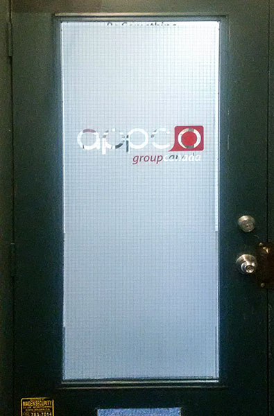 frosted-vinyl-with-a-combination-of-red-vinyl-for-company-logo-on-a-glass-door