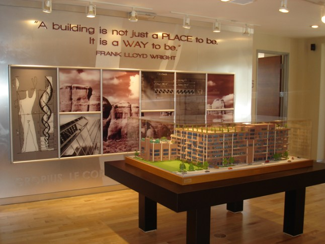 Dimensional acrylic letters with wall graphics and mounted image framing system