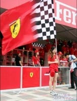 girl waving Ferrari big flag