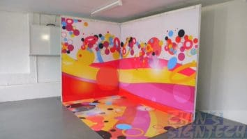 fabric graphics fix directly to the shell scheme walls with floor graphics