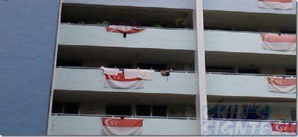 Faded screen printed Singapore flag hand at HDB