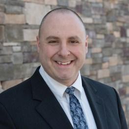Dr. Corey Olsen