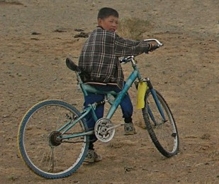 In our excitement, we hadn't noticed the little boy trailing behind Future on a blue bicycle.