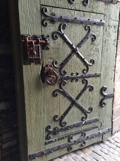 Such a cool door! I love the little mini door within the big door. How can you not imagine your knight in shining armour racing through the gates on his horse, with a dragon in hot pursuit?!