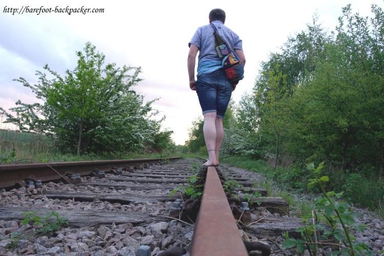 barefoot on a railway line