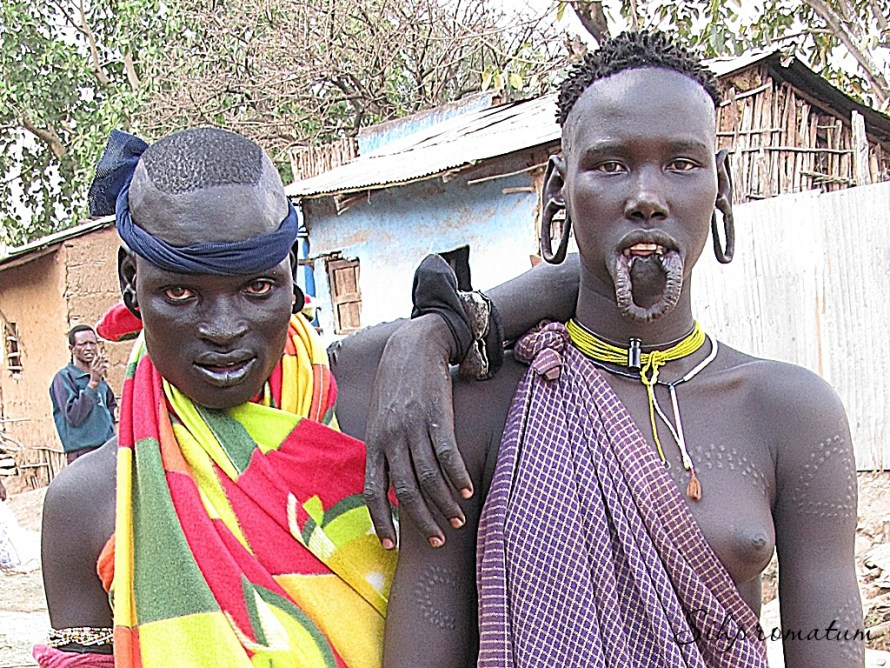 These Surma people are practicing the tradition of lip plates still.