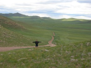 """""""Ulaanbaatar had been replaced by open fields and rolling hills very suddenly, vanishing as quickly as it had risen out of dust."""""""