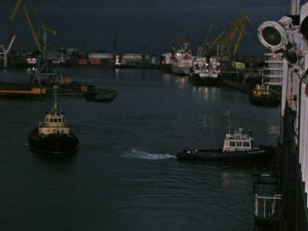 Cute tug boats helping us out of port