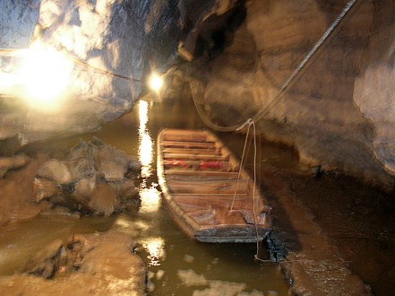 We floated into the darkness of the cave in a little wooden rowboat. The low, flowing river was too narrow for oars, so we relied on muscle power to pull ourselves through the entrance using a thick, wet rope attached to a rock somewhere in the cave's inner shadows.