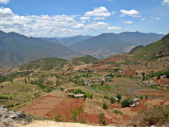 """In a few days, we'd be returning to the quiet village to restock on essentials, but right now, the two-hour drive out of Lijiang highlighted an impressive mountain range that towered over us and prompted me to imagine I was immersed in a new level of Zelda, carrying """"items"""" and """"potions"""" on my back."""