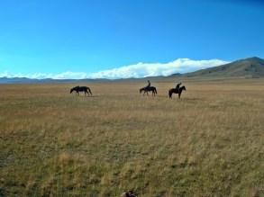 Horse country Song Kol, Kyrgystan. Backpacks and Bra Straps