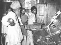 Bhagat ji working at the printing press