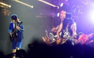 Angus Young of AC/DC performs onstage with Axl Rose and Slash of Guns N' Roses at the 2016 Coachella Festival