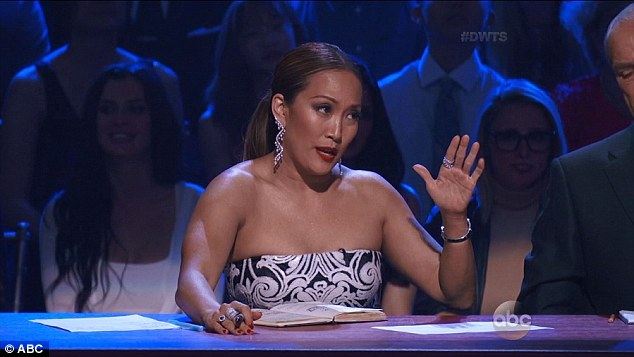 Tear-jerker:As the performance ended, his pro partner Peta Murgatroyd failed to hold back her tears, as did judge Carrie Ann Inaba (pictured)