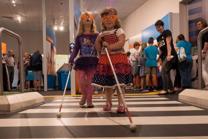 Emily and Olivia Webb experience what it is like to walk with a white cane.