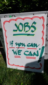 Many of the signs carried by people at the Deaf Grassroots Movement rally dealt with employment and education access.