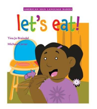 Little girl signing eat