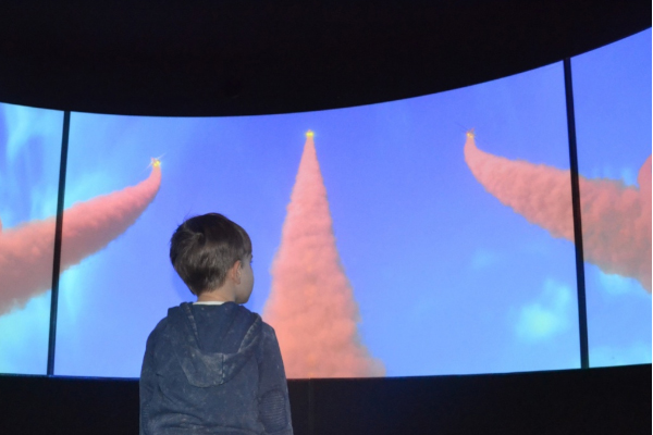 A young child watching the screen
