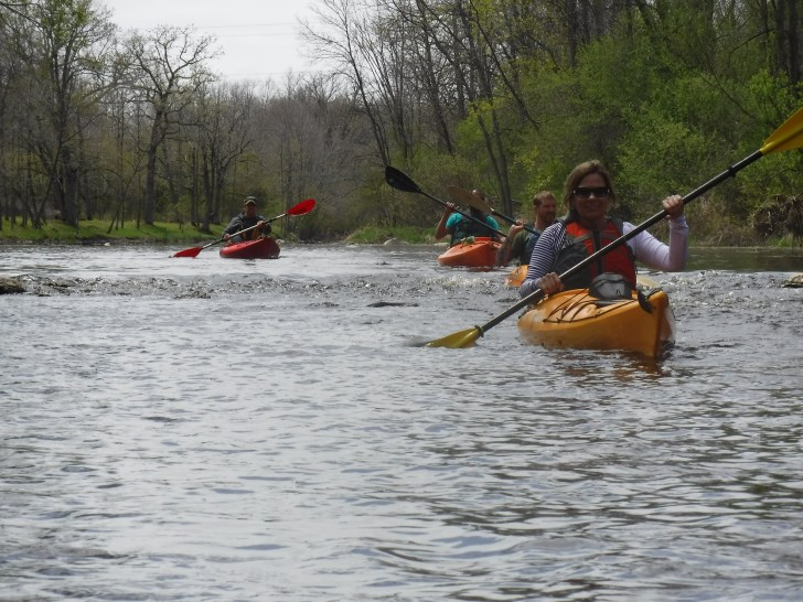 kayaking cedar creek near covered bridge cedarburg