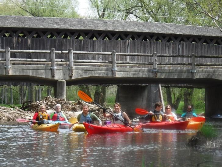 kayaking cedar creek near covered bridge cedarburg