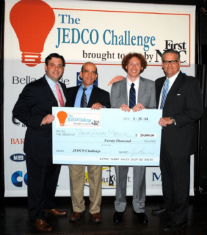 After winning the 2014 JEDCO Challenge, the PortaVision team posed for pictures with the $20,000 check from First NBC Bank.