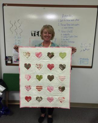 Julie finishes her Valentine's Day wallhanging quilt just in time for the holiday. We heart it!
