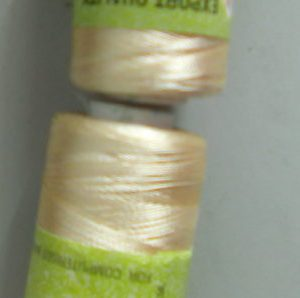 Cream colour silk thread