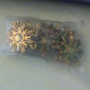 antique gold sun charm
