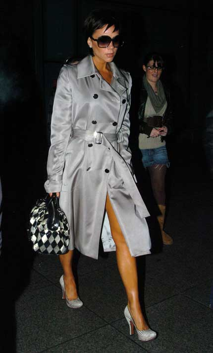 Victoria Beckham in silver trench coat