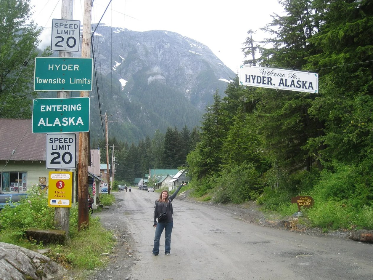 Val in front of the Welcome to Hyder, Alaska sign.
