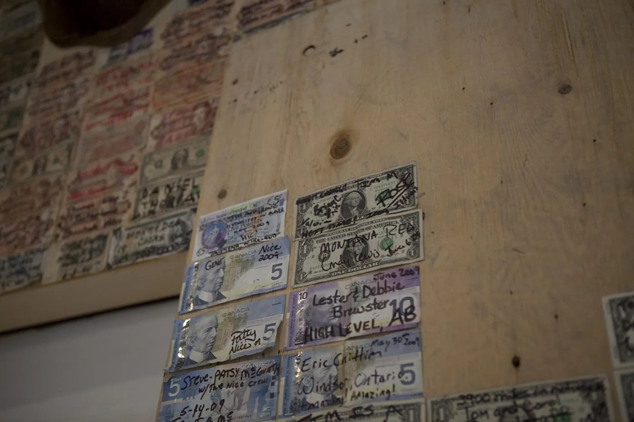 Signed dollars from all over the world on the wall of the Glacier Inn in Hyder, Alaska.