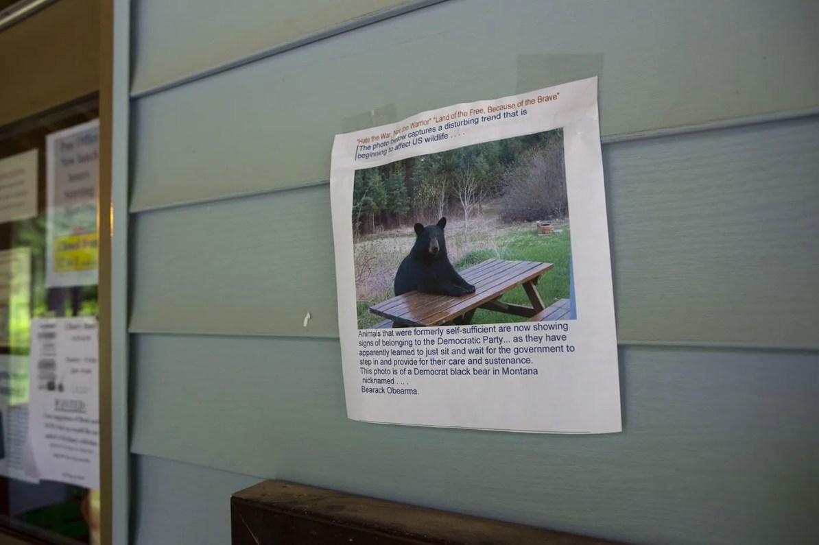 Bear at a picnic table sign at the Hyder, Alaska Post Office.