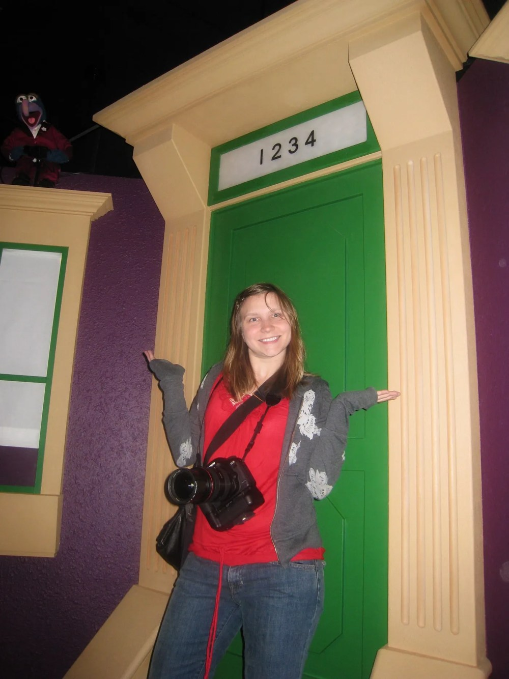 Val in front of a Sesame Street door at the Jim Henson's Fantastic World exhibit at the Experience Music Project/Science Fiction Museum in Seattle, Washington.