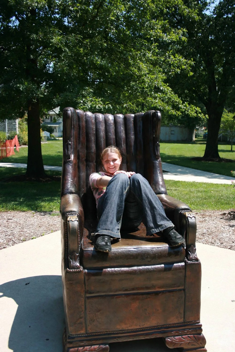 Val sits on the replica of Robert Wadlow's chair in Alton, Illinois. Robert Wadlow was the World's Tallest Man.