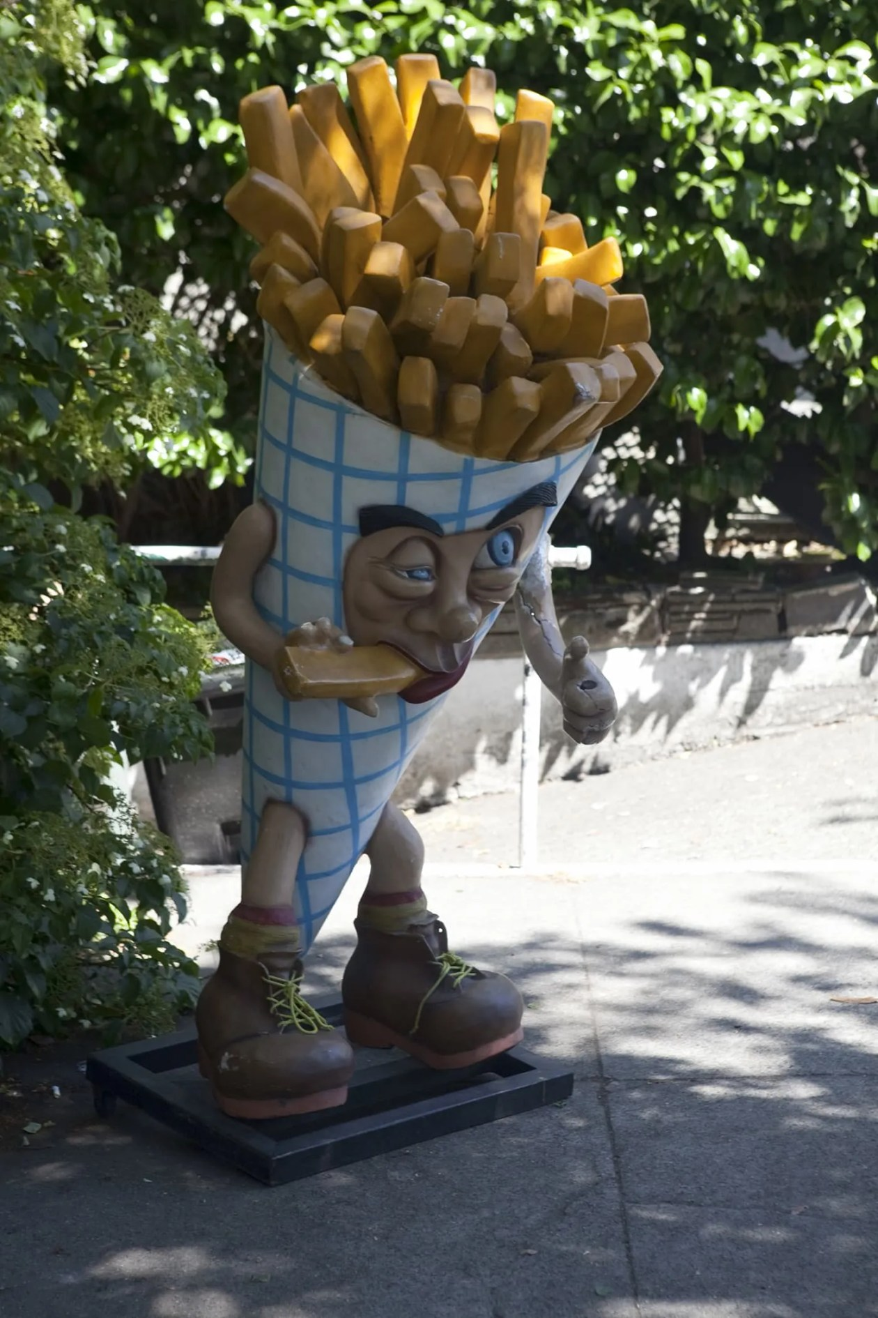 Deluxe Junk Fry Guy -  Giant cone of french fries eating a french fry outside of Deluxe Junk in Fremont, Seattle, Washington.
