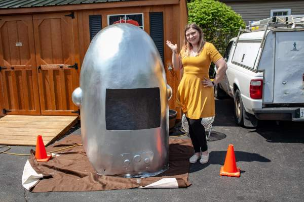 Val with the Gemini Giant Muffler man's helmet at the Launching Pad Drive In in Wilmington, Illinois on Route 66.