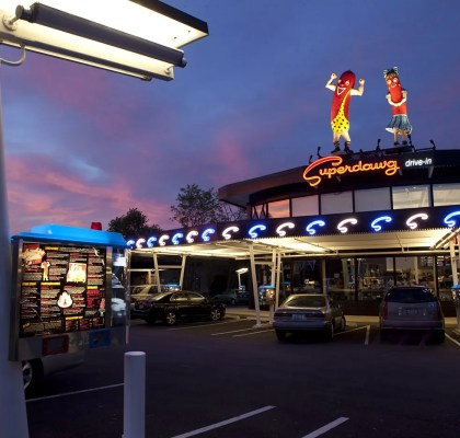 New giant hot dogs on the roof of Superdawg Wheeling.