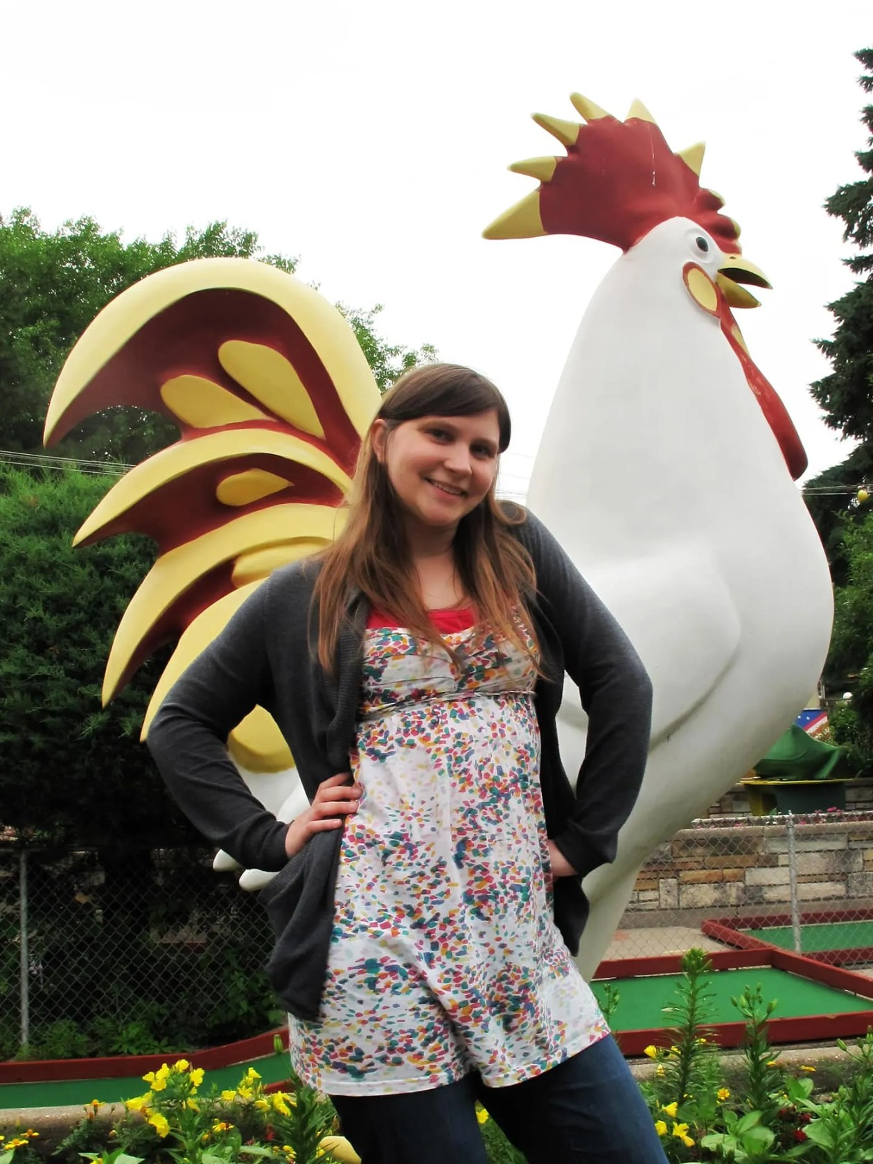 Val and a rooster at Novelty Golf in Lincolnwood, Illinois.