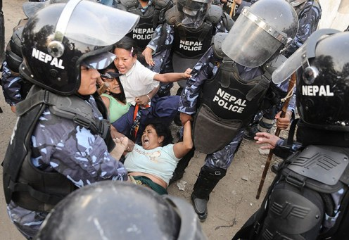 Local Police arresting people resisting the Government's move