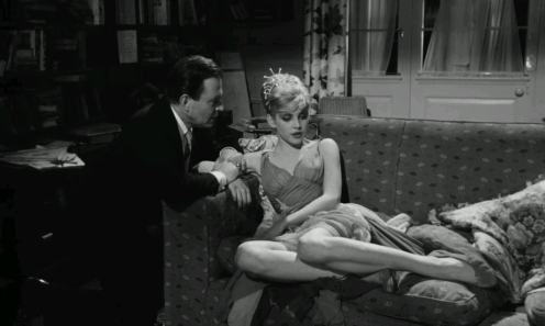 A scene from Lolita (1962): Humpert and Lolita discussing in a room.