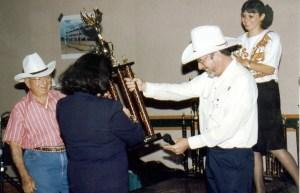 Jose Silva, Ed Bernd Jr., Katherine Sandusky present Silva Sales Power award