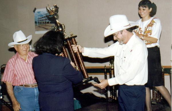 Jose Silva, Ed Bernd Jr., Katherine Watson present Sales award